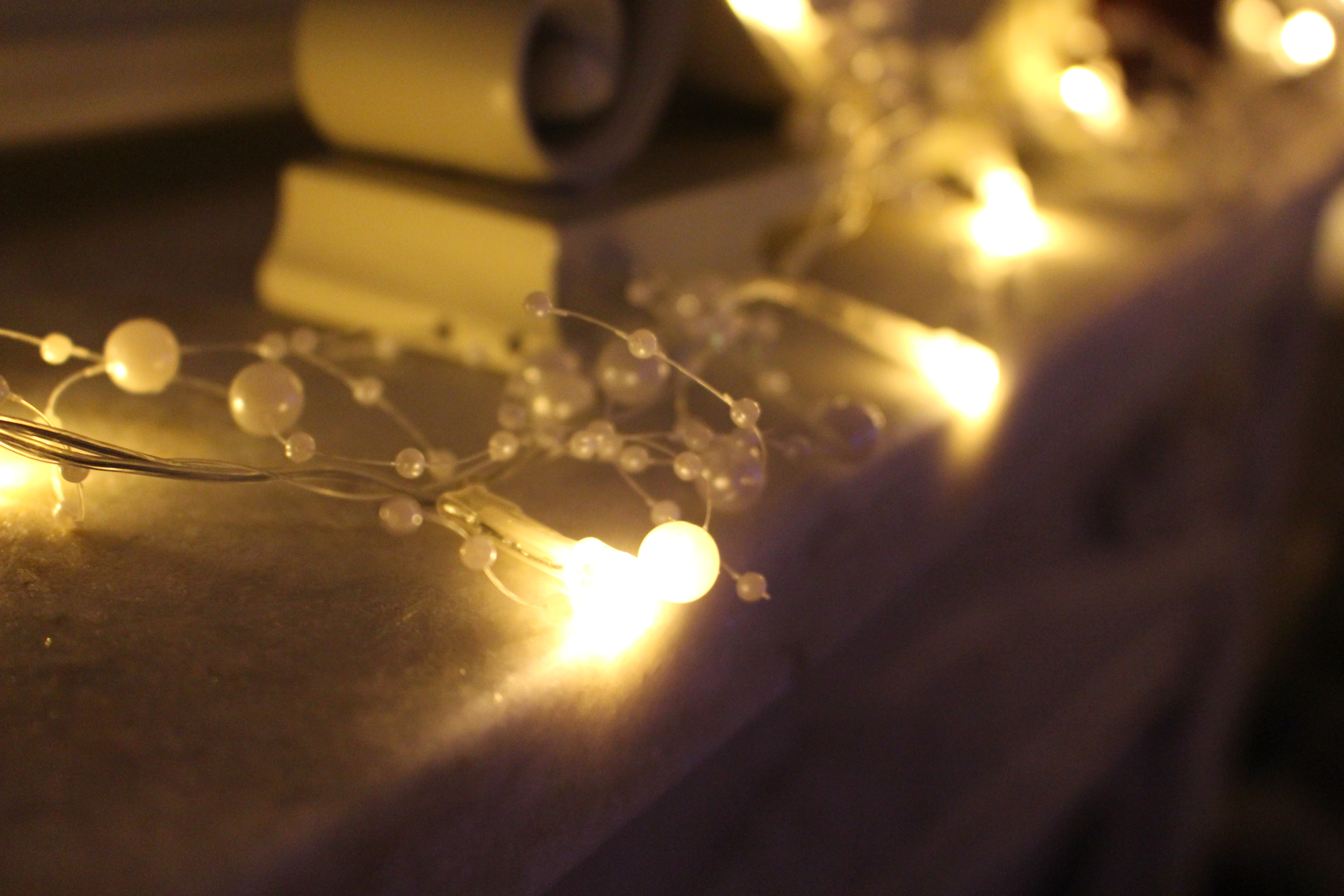 here to add the touch of winter that stands out i have some white pearl that sparkles glass candles and the lasting family photos
